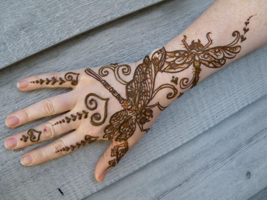 Dragonflies and butterflies henna tattoo