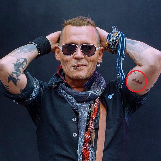Three Hearts Tattoo of Johnny Depp