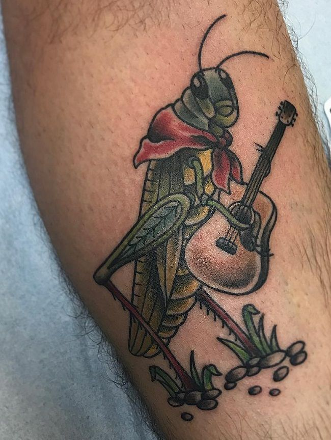 Grasshopper holding a Guitar Tattoo