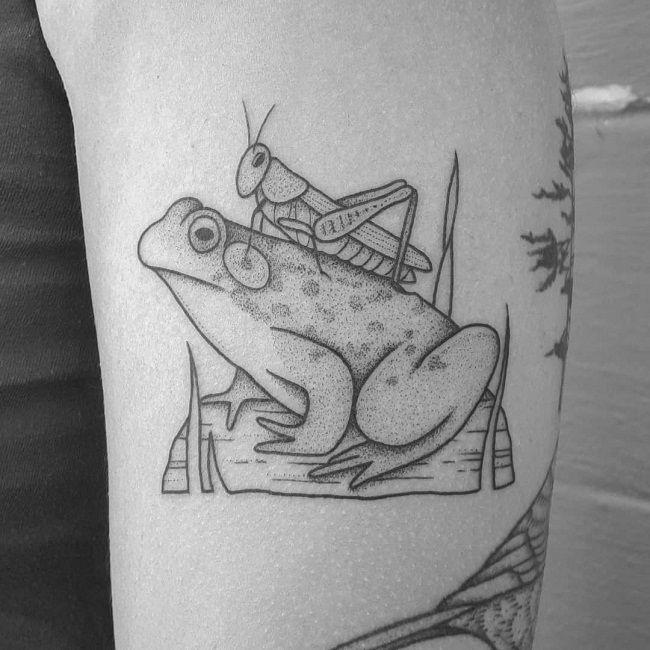 Grasshopper sitting on the Frog Tattoo