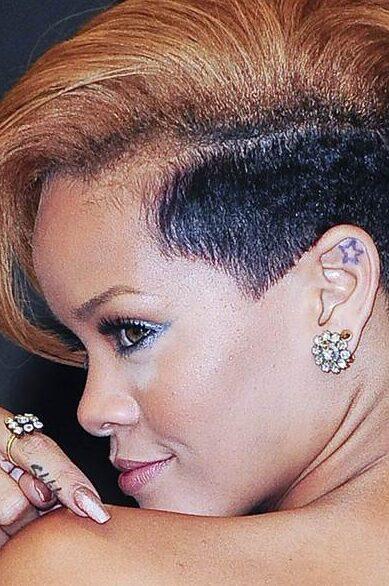 Star tattooof Rihanna on ear